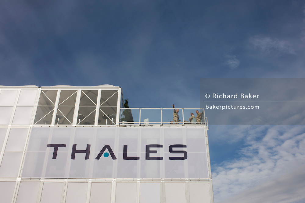 Military guests of Aerospace manufacturer Thales hospitality chalet at the Farnborough Airshow.