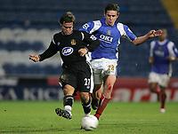 Photo: Lee Earle , Digitalsport<br /> Portsmouth v Wigan Athletic. The FA Cup. 06/01/2007.  Kristofer Hæstad Wigan's (L) sprints away from Sean Davis.
