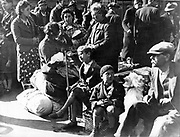 World War II: Paris, July 1940:  Belgian refugee families waiting at the Gare du Nord to be repatriated.  By this time, Paris was under German occupation