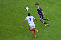 LENS, FRANCE - Thursday, June 16, 2016: Wales' James Chester in action against England's Danny Rose during the UEFA Euro 2016 Championship Group B match at the Stade Bollaert-Delelis. (Pic by Paul Greenwood/Propaganda)