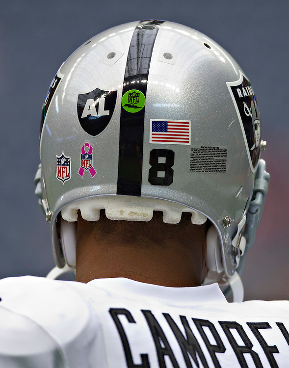 HOUSTON, TX - OCTOBER 9:  Back of the Oakland Raiders helmet with AL sticker to honor Al Davis during a game against the Houston Texans at Reliant Stadium on October 9, 2011 in Houston, Texas.  The Raiders defeated the Texans 25 to 20.  (Photo by Wesley Hitt/Getty Images) *** Local Caption *** Al Davis; Jason Campbell