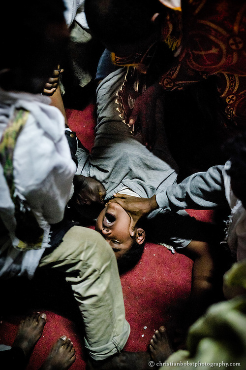 An exorcism is performed at a rock-hewn church in Lalibela, Ethiopia during Mescel, one of the highets days of the Ethiopien orthodox church. The festival is known as Feast of the Exaltation of the Holy Cross in other Orthodox, Catholic or Protestant churches. With its 900-year-old churches carved from rock, the Ethiopian town of Lalibela attracts tens of thousands of pilgrims from all over Ethiopia each year.