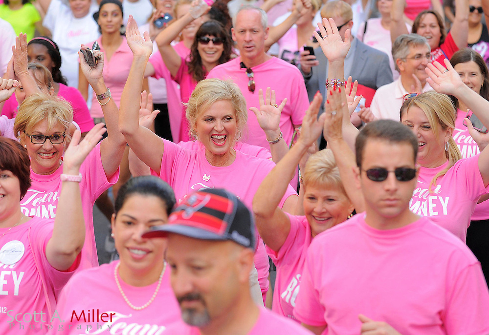 "Ann Romney, wife of US Presidential Hopeful Mitt Romney, waves to on lookers as she takes part in the ""Making Strides Against Breast Cancer 5k"" in Orlando, Florida October 20, 2012.  ©2012 Scott A. Miller."