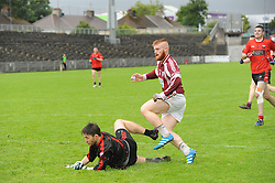 Keeper turns goal poacher &hellip;.Balla&rsquo;s Matthew Flanagan gets his shot past Ballycastle keeper Jason O&rsquo;Neill to score in the junior semi final.<br />Pic Conor McKeown