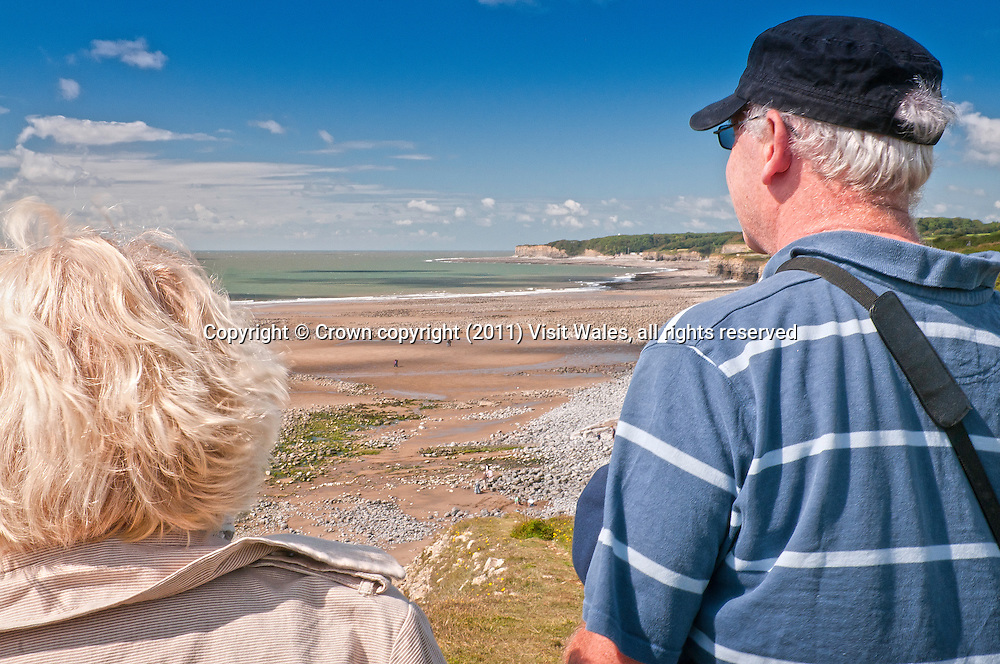 Walkers on coast path above Colhuw Beach<br /> Near Llantwit Major<br /> Glamorgan Heritage Coast<br /> Vale of Glamorgan<br /> South<br /> Walking<br /> Activities and Sports