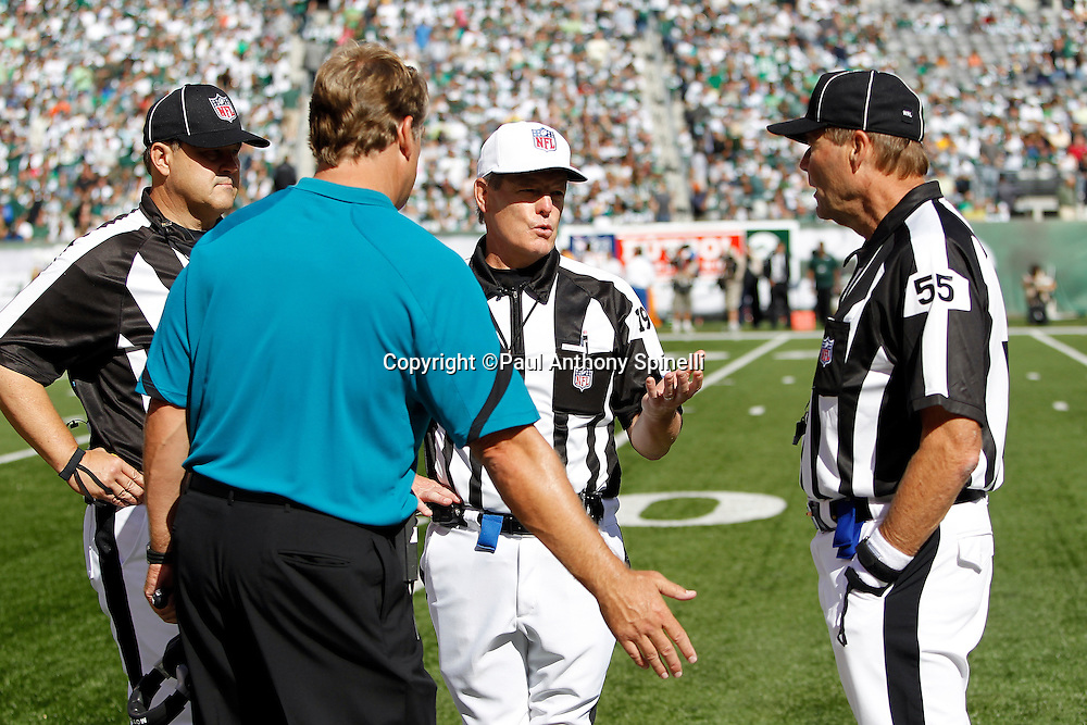 Jacksonville Jaguars head coach Jack Del Rio argues with NFL officials while referee Scott Green (19) makes a point during the NFL week 2 football game against the New York Jets on Sunday, September 18, 2011 in East Rutherford, New Jersey. The Jets won the game 32-3. ©Paul Anthony Spinelli
