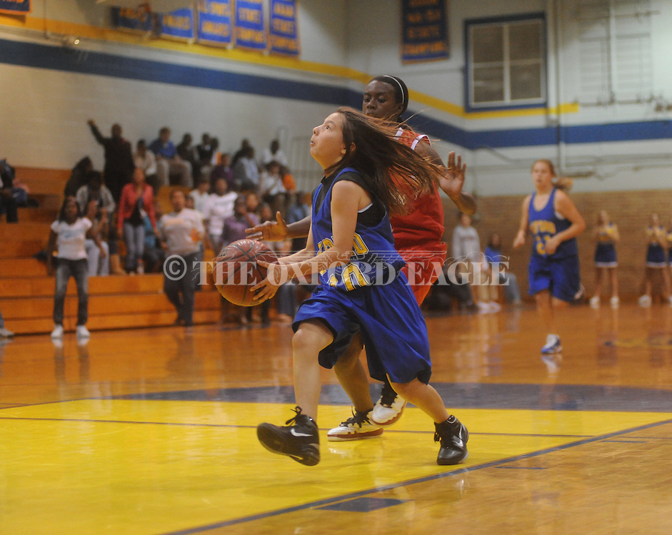 Oxford Middle School's Emma Schultz (10) vs. South Pontotoc's Maddison Crudup (13) in girls 7th grade basketball action in Oxford, Miss. on Monday, November 1, 2010.