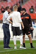 Cleveland Browns rookie quarterback Baker Mayfield (6) talks to former Dallas Cowboys quarterback and current day television announcer Troy Aikman (left) and New York Jets quarterback Josh McCown (15) before the 2018 NFL regular season week 3 football game against the New York Jets on Thursday, Sept. 20, 2018 in Cleveland. The Browns won the game 21-17. (©Paul Anthony Spinelli)