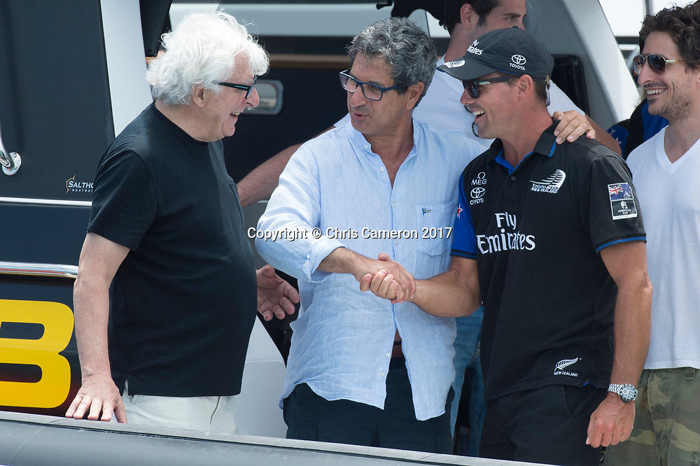 The Great Sound, Bermuda, 26th June 2017. Prada owner Patrizzio Bertelli, Yacht club commodore for Circolo Della Vela, Agostino Randazzo and Commodore for the Royal New Zealand Yacht Squadron Steve Mair shake hands as the new challenger of record and the holders of the America's Cup. Photo: Chris Cameron / www.photosport.nz