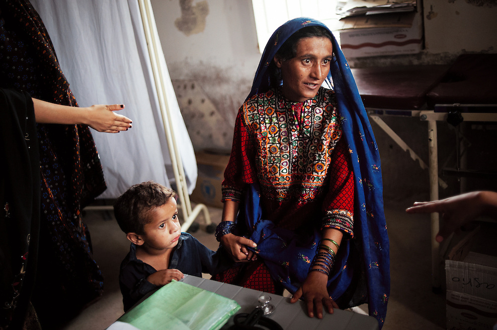 A women and child are treated  by health workers at the Government Health Clinic in the village of Babrio Jat, Thatta, Sindh, Pakistan on July 2, 2011.