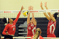 Lenape's Laren Benson #8 tries to volley as Rancocas Valley's Lauryn Bayley #16 and Maya Dingle #6 defend during a volleyball match Saturday October 10, 2015 at Moorestown High School in Moorestown, New Jersey. (Photo by William Thomas Cain)