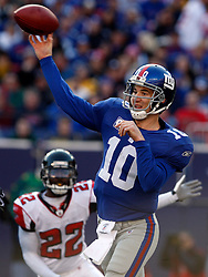Nov 22, 2009; East Rutherford, NJ, USA; New York Giants quarterback Eli Manning (10) throws a pass during the first half of their game against the Atlanta Falcons at Giants Stadium. Mandatory Credit: Ed Mulholland
