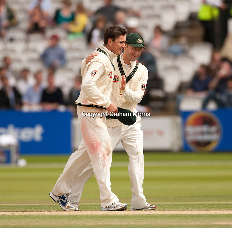 Marcus North (bare-headed, 6 for 55) is congratulated by vice-captain Michael Clarke after winning the MCC Spirit of Cricket Test Match between Pakistan and Australia at Lord's.  Photo: Graham Morris (Tel: +44(0)20 8969 4192 Email: sales@cricketpix.com) 16/07/10