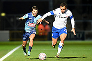 Wycombe Wanderers striker Scott Kashket (11) battles for possession  with Tranmere Rovers defender (on loan from West Bromwich Albion) Kane Wilson (22) during the The FA Cup match between Wycombe Wanderers and Tranmere Rovers at Adams Park, High Wycombe, England on 20 November 2019.