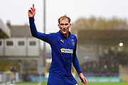 AFC Wimbledon midfielder Mitchell (Mitch) Pinnock (11) pointing finger to sky after a foul and talking to the linesman during the EFL Sky Bet League 1 match between AFC Wimbledon and Lincoln City at the Cherry Red Records Stadium, Kingston, England on 2 November 2019.
