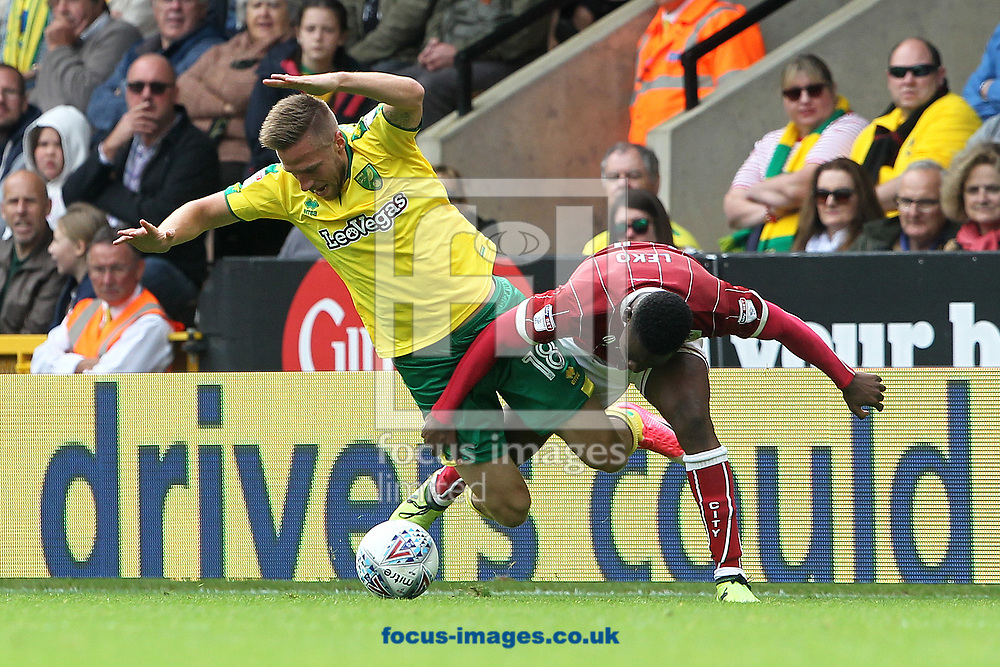 Marco Stiepermann of Norwich and Jonathan Leko of Bristol City in action during the Sky Bet Championship match at Carrow Road, Norwich<br /> Picture by Paul Chesterton/Focus Images Ltd +44 7904 640267<br /> 23/09/2017