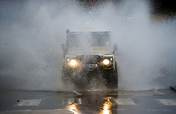 © Licensed to London News Pictures. 25/11/2012..North East England..A Land Rover drives through a heavily flooded road near to Saltburn, Cleveland following a night of heavy rain that caused traffic disruption and flooding in parts of Cleveland and North Yorkshire this morning...Photo credit : Ian Forsyth/LNP
