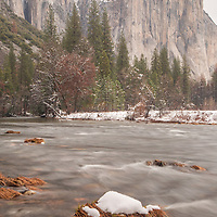 El Capitan overlooks a snowy Merced River. Yosemite National Park, CA