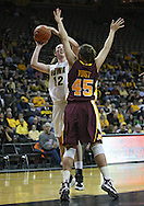 February 18, 2010: Iowa center Morgan Johnson (12) puts up a shot over Minnesota forward Jackie Voigt (45) during the second half of the NCAA women's basketball game at Carver-Hawkeye Arena in Iowa City, Iowa on February 18, 2010. Iowa defeated Minnesota 75-54.