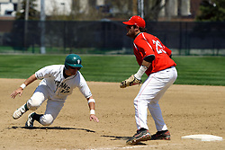 21 April 2007: Josh Bidzinski dives back to first as Chris Sajdak awaits the throw. Carthage College loses the first game of a double header by a score of 5-2 against the Illinois Wesleyan Titans.