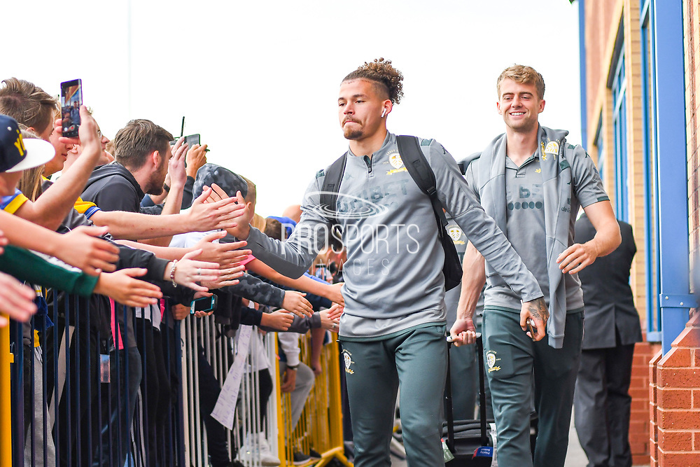 Leeds United midfielder Kalvin Phillips (23) and Leeds United forward Patrick Bamford (9) arrive at the ground during the EFL Sky Bet Championship match between Leeds United and Brentford at Elland Road, Leeds, England on 21 August 2019.