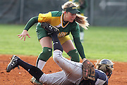 David W. Smith/ Daily News<br /> Lady Dragon baserunner Mason Dunisi gets back safely to second under the tag of Lady Gator Kaysha Wheeler  during a girls District softball game at Greenwood High School Tuesday.