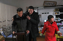 epa05751038 (17/22) Chinese migrant worker Wang Pengfei (C) hugs his father Wang Weiqiao (L) as his daughter Yaqin (R) walks by in their home in Heze City, Shandong Province, China, 22 January 2017. Wang is the migrant worker and is working in the capital city as a delivery man. He will travel to visit his family in the Shandong Province for the annual Chinese Lunar New Year or Spring Festival. This is the only time he gets to see his family each year. Wang will join millions of fellow Chinese travelers making their way back home as they pack trains, planes and buses, in what is the largest human migration in the world. The journey, known as 'Chunyun' - the annual spring migration, will involve a total of 2,98 billion trips, starting from 13 January and continuing until 21 February 2017.  EPA/HOW HWEE YOUNG PLEASE REFER TO THE ADVISORY NOTICE (epa05751021) FOR FULL PACKAGE TEXT