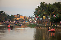 A boat trip on the Thu Bon river is a popular activity for locals and tourists alike in Hoi An, Vietnam