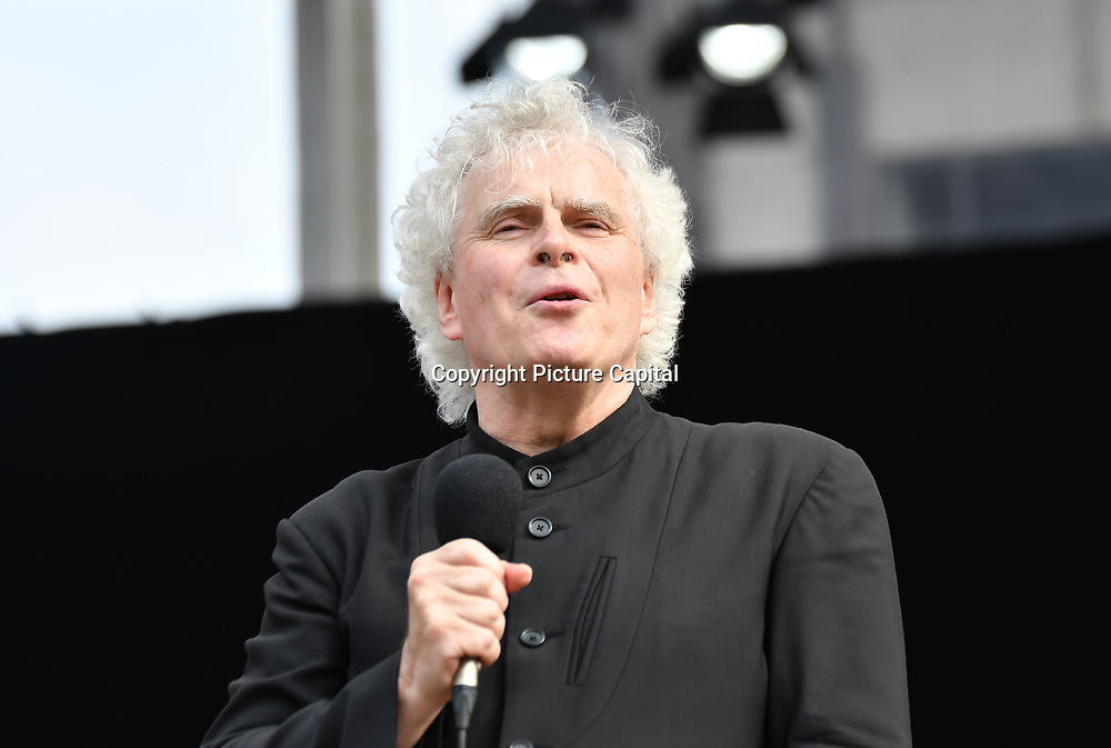 Sir Simon Rattle conductor the BMW Classics + live streamed on YouTube in Trafalgar Square on a hot weather in London, UK on July 1st 2018.