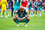 Swansea City forward Andre Ayew (22) looks disappointed after full-time whistle during the EFL Sky Bet Championship match between Barnsley and Swansea City at Oakwell, Barnsley, England on 19 October 2019.