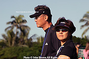 Fifteen year old Michelle Wie's parents follow her on the course during a practice round prior to the PGA 2005 Sony Open In Hawaii.  The event was held at The Waialae Country Club in Honolulu.