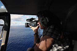 INDIAN OCEAN 26MAR13 - Videographer Sarah Scragg of Australia works aboard the helicopter whilst flying over the Indian Ocean.<br /> <br /> <br /> <br /> The Esperanza is on patrol in the Indian Ocean looking for illegal fishing vessels.<br /> <br /> <br /> <br /> jre/Photo by Jiri Rezac / Greenpeace