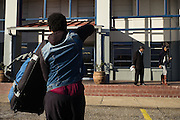 "MONTGOMERY, AL – JANUARY 25, 2016: Cabbie Michael Harris (center) courts a potential customer at the new Greyhound bus station on South Boulevard. In 2011, the downtown Montgomery Greyhound bus station was converted into a museum to honor the freedom riders, who endured a violent attack there in 1961. The replacement bus station, located four miles from downtown, is a prime business opportunity for independent cabbies like Michael Harris, who make a living serving passengers unwilling to rely on city buses. Many characterize the public bus system in Montgomery as unsafe and unreliable, so wary passengers cough up $2 per mile for trips in Mr. Harris' 2005 Lincoln Navigator, traveling across town for fast food, or sometimes as far as New York City. ""This is my life,"" Harris said. ""I love driving, and I help people out. It's just in my heart."""