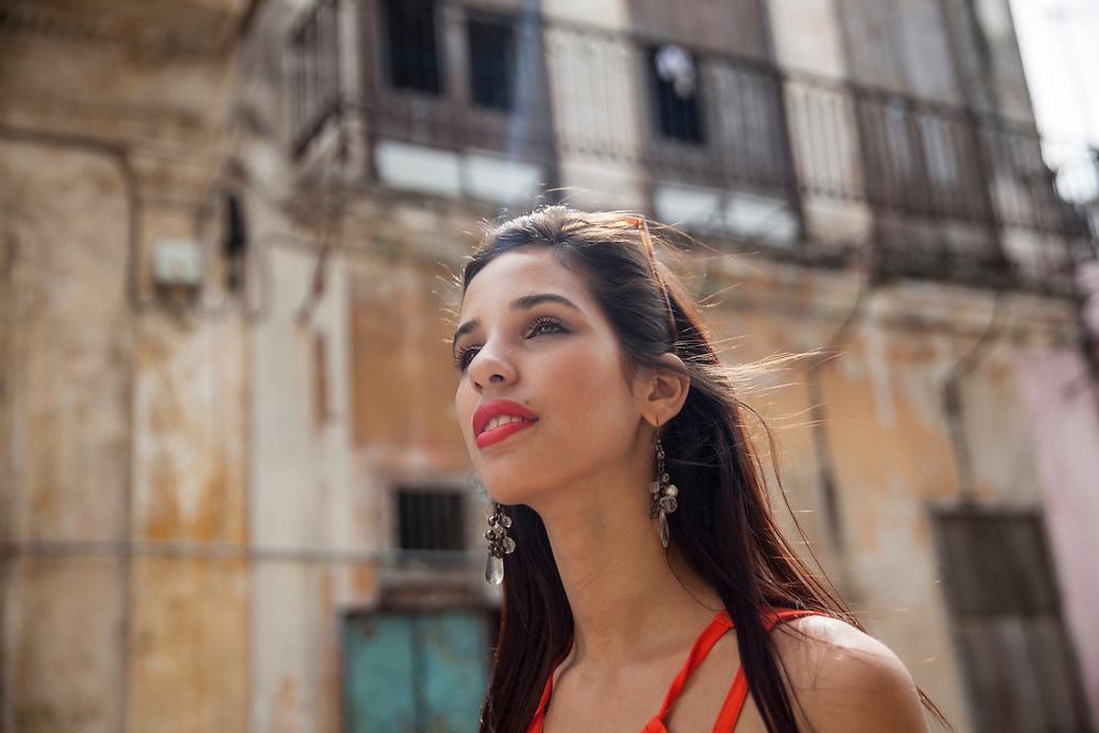 Cuban Pretty young woman strolling down the streets of Old Havana in Cuba.