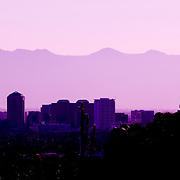 The Phoenix skyline at dusk as seen from a hiking trail leading to Piestewa Peak in Phoenix, Arizona.