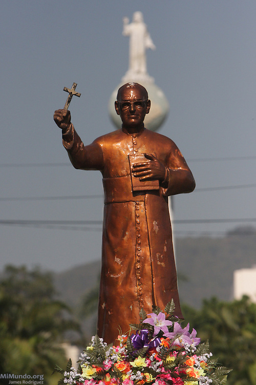 Statue of Monsignor Oscar Romero and the Monument to the Savior of the World in San Salvador. On March 24th, 1980, Monsignor Romero, Archbishop of San Salvador, was gunned down by a professional sniper while giving a mass in the chapel of the Divina Providencia Hospital. Monsignor Romero had become a recognized critic of violence and injustice and was therefore perceived as a dangerous enemy by certain military and right wing groups in El Salvador. San Salvador, El Salvador. March 24, 2010.