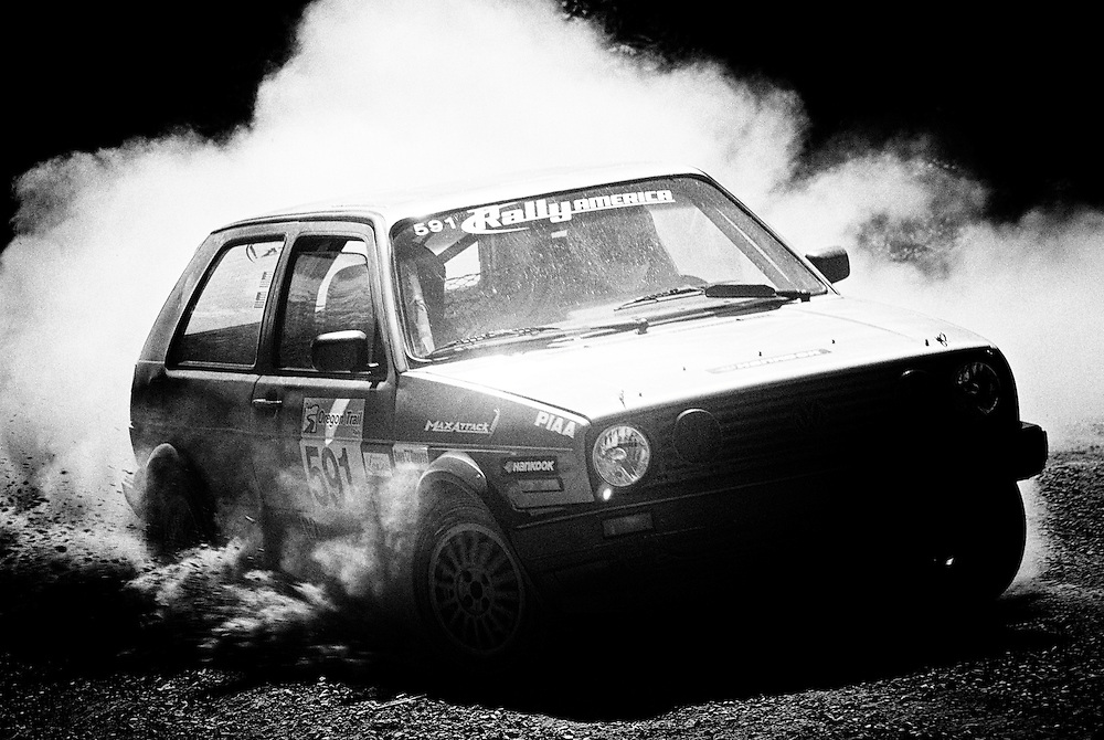 Day three of the Oregon Trail Rally was about forty five minutes West of Portland in heavily treed stages. VW Rabbit GTI tosses some front wheel roost in deep gravel during an early stage of the race.