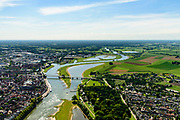 Nederland, Gelderland / Overijssel, Deventer, 17-07-2017; IJssel met uiterwaarden ter hoogte De Worp, tegenover stadscentrum. Om het IJsselwater bij hoogwater sneller af te voeren zijn bij Deventer zijn in het kader van het programma Ruimte voor de Rivier de uitwaarden vergraven om een hoogwatergeul te creëren. <br /> NOOT: Zie ook opnames van de oorspronkelijke situatie.<br /> IJssel with floodplains. In order to facilitate the flood of water from river IJssel at high waters, floodplains have been has excavated and and a flood chanel has been created.<br /> See also recordings of the original situation.<br /> luchtfoto (toeslag op standard tarieven);<br /> aerial photo (additional fee required);<br /> copyright foto/photo Siebe Swart