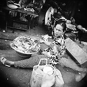 Streeteyes was a participatory photography project conducted with the residents of the Green Bamboo Shelter, a refuge for former street kids in Ho Chi Minh City, Vietnam. Edited by and under the direction of documentary photographer Quinn Ryan Mattingly, each young photographer used a Holga camera and black and white film. They were asked to create a self portrait by double exposing their face and their name found somewhere in the city, then told to finish the roll by capturing whatever they found interesting. What resulted was a visual exploration of the streets of Saigon through the eyes of its young residents.<br /> <br /> Each photographer's portrait is followed by three of their best images.<br /> <br /> The collection was recently exhibited in Saigon and all the prints were sold to raise money for each photographer and their family.
