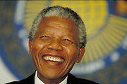 Nelson Mandela, recently released from Pollsmoor Prison in South Africa attends CHOGM in Harare Zimbawe. <br /> <br /> Tel 0044(0)208 944 6933<br /> www.linkphotographers.com Photography by Orde Eliason
