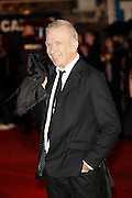 Jean Paul Gaultier poses as he arrives at NRJ Music Awards 2012 at Palais des Festivals on January 28, 2012 in Cannes.Jean Paul Gaultier arrive au NRJ Music 2012 Prix au Palais des Festivals le Janvier 28 2012 à Cannes.