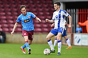 Scunthorpe United midfielder Josh Morris (11)  and Chesterfield FC defender Paul McGinn (2)  during the EFL Sky Bet League 1 match between Scunthorpe United and Chesterfield at Glanford Park, Scunthorpe, England on 17 April 2017. Photo by Ian Lyall.