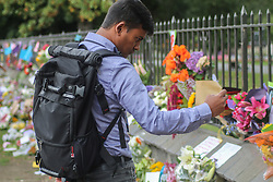 March 16, 2019 - Christchurch, Canterbury, New Zealand - A Bangladeshi media member who was following the Bangladeshi cricket team pays respect to the victims of terror attacks, the team and media members narrowly avoided being caught in the attack as they were late to the mosque after a press conference ran over time. Around 50 people has been reportedly killed a terrorist attack onn two Christchurch mosques. (Credit Image: © Adam Bradley/SOPA Images via ZUMA Wire)