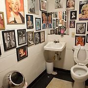 Mens bathroom at the Polk=-a-Dot drive in decorated with photographs of Marilyn Monroe. Historic U.S. Route 66 starts in Chicago traveling through 6 states and ending in Santa Monica, California.<br /> Photography by Jose More