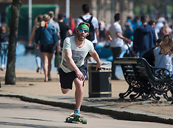 © Licensed to London News Pictures. 22/04/2019. London, UK. A man skateboarding in the heat in Hyde Park, central London on what has been a record breaking Easter bank holiday weekend for temperatures. Photo credit: Ben Cawthra/LNP