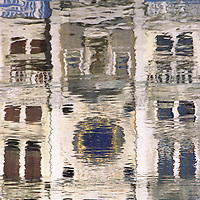 Wavy reflection of Marzaria Tower/clock in pooled water of Piazza San Marco