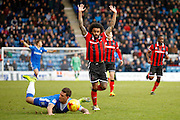 Shrewsbury Town FC midfielder Junior Brown (12) commits a foul on Gillingham FC forward Cody McDonald (10) during the EFL Sky Bet League 1 match between Gillingham and Shrewsbury Town at the MEMS Priestfield Stadium, Gillingham, England on 28 January 2017. Photo by Andy Walter.