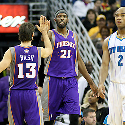 December 30, 2011; New Orleans, LA, USA; Phoenix Suns point guard Steve Nash (13) celebrates with forward Hakim Warrick (21) as New Orleans Hornets point guard Jarrett Jack (2) walks back to the bench following a time out during the second half of a game at the New Orleans Arena. The Suns defeated the Hornets 93-78.   Mandatory Credit: Derick E. Hingle-US PRESSWIRE