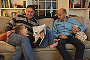 Family gathering at holiday includes father and son and father of second family.