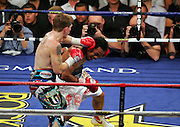 Ricky Hatton connects with a left hook before Manny Pacquiao knocks  him out in the second round of their Light Welterweight title fight at the MGM Grand, Las Vegas , Nevada, 2nd May 2009.